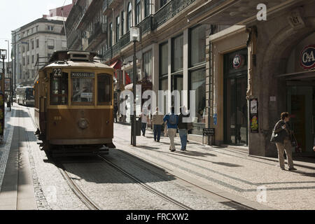 Tram on the boardwalk in Santa Catarina street of Oporto - Stock Photo
