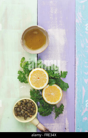 Chimichurri parsley sauce. Ingredients for making chimichurri sauce on rustic table - Stock Photo
