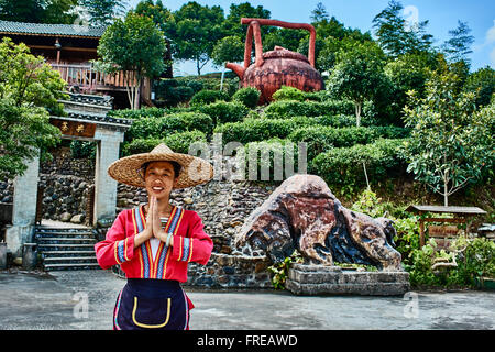 Guangxi, China - September 29, 2014 :Chinese woman in front of traditional tea house  between Guilin and Yangshuo - Stock Photo