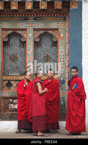 Monks in front of the Punakha Dzong, Buddhist monastery fortress, Punakha district, Bhutan - Stock Photo