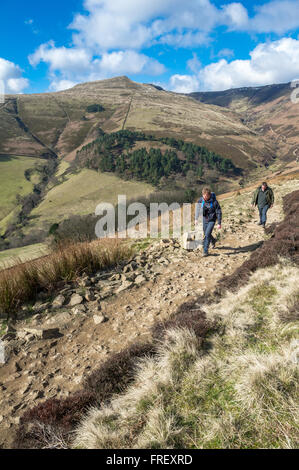 Walkers at The Nab walking to the Ringer Roger on the Pennine way in the Peak District, Derbyshire, England, U.K. - Stock Photo