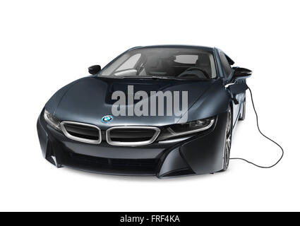 Black 2016 BMW i8 plug-in hybrid electric luxury sports car with charging cord isolated on white background with - Stock Photo