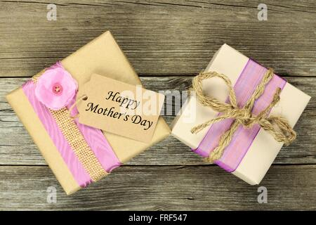 Rustic gift boxes with Happy Mother's Day tag on a wood background - Stock Photo