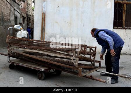 BAKU, AZERBAIJAN - APRIL 24 2014  Hand trailer with taxi sign being pulled by a man in Baku, capital of Azerbaijan - Stock Photo