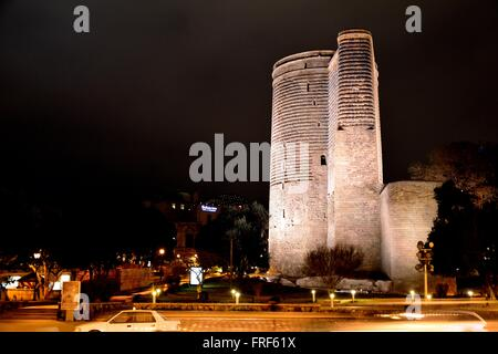 Maiden's Tower at night in Baku, capital of Azerbaijan. On the Caspian Sea in the old city, this building is entwined - Stock Photo