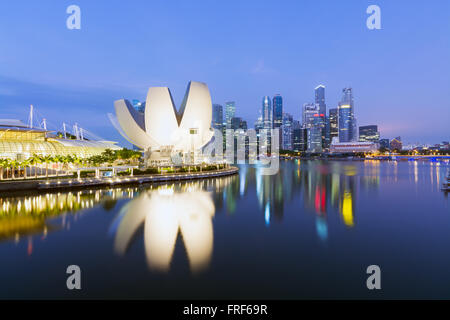 Singapore - Singapore April 10, 2014: The `Lotus flower` of the ArtScience Museum  and the Central business district - Stock Photo