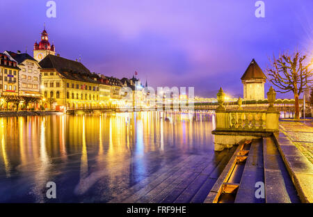 Lucerne, Switzerland. View over Reuss river to the old town and Water tower in the evening. - Stock Photo