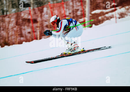 downhill racer young men in competition Russian Cup in alpine skiing - Stock Photo