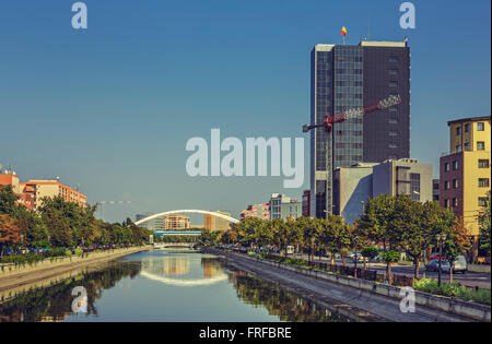 Bucharest, Romania - August 14, 2013: Picturesque city view with Dambovita river passing through Grozavesti district. - Stock Photo