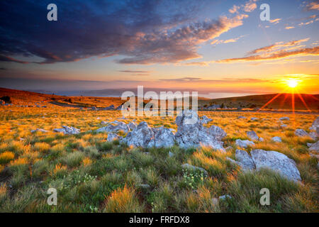 Sunset mountain landscape, View to island Krk from Velebit in Croatia. - Stock Photo