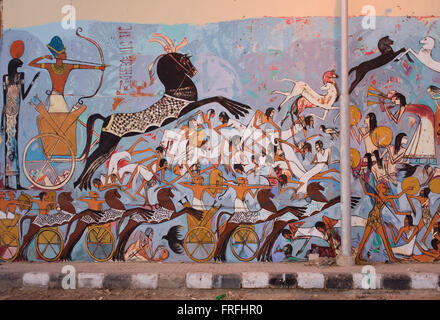 Modern hieroglyphic artwork painted on a wall of local wasteground in the village of Gezirat on the West Bank of - Stock Photo