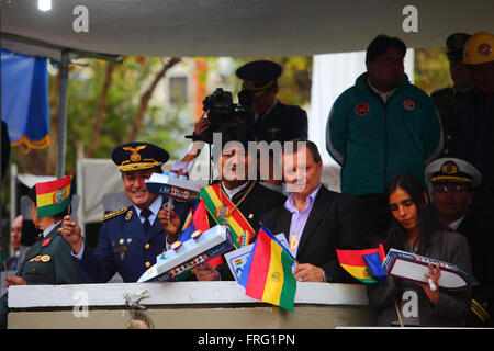 La Paz, Bolivia - March 22 2016: Bolivian President Evo Morales (centre) holds a model ship as hes watches military - Stock Photo