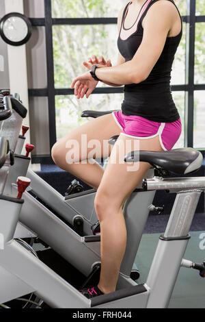 Woman using smart watch - Stock Photo