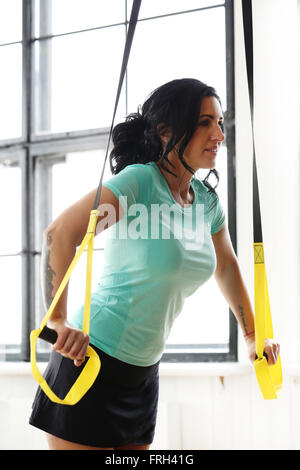 Girl at gym - Stock Photo