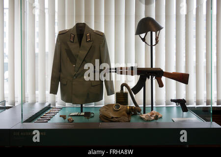 Weapons and uniforms at Stasi Museum, Berlin - Stock Photo