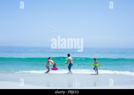 Family playing at sea shore - Stock Photo