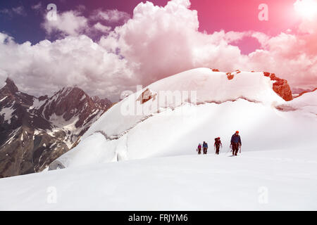 Group of Mountaineers Walking on Ice Field - Stock Photo