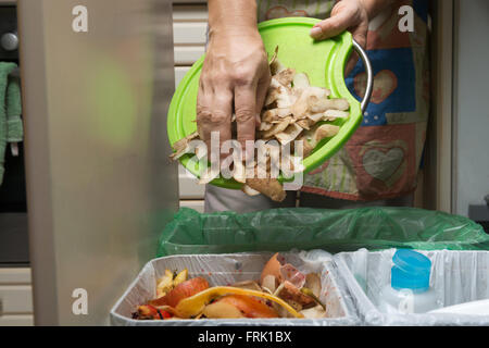 Household waste sorting and recycling kitchen bins in the drawer. Collecting food leftovers for composting. Environmentally - Stock Photo