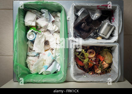 Household waste sorting and recycling kitchen bins in the drawer. Environmentally responsible behavior concept, - Stock Photo