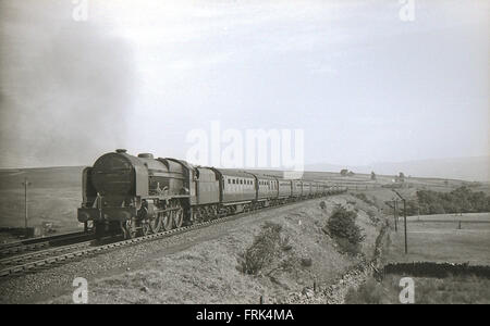 LMS Royal Scot 4-6-0 6136 The Border Regiment on a train - Stock Photo