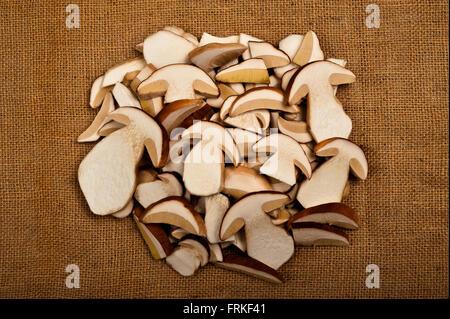 Sliced mushrooms on jute background - Stock Photo