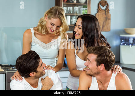Young couples spending leisure time at home - Stock Photo