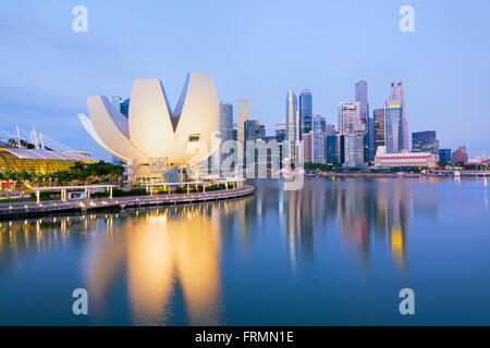 Singapore - Singapore April 10, 2014: The `Lotus flower` of the ArtScience Museum  and the Central business district, - Stock Photo