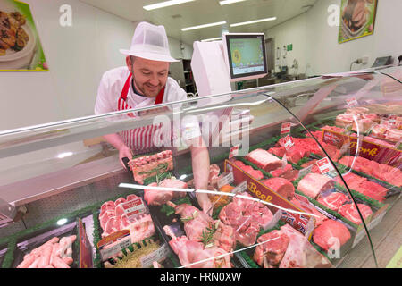 A butcher at a Morrisons fresh look store - Stock Photo