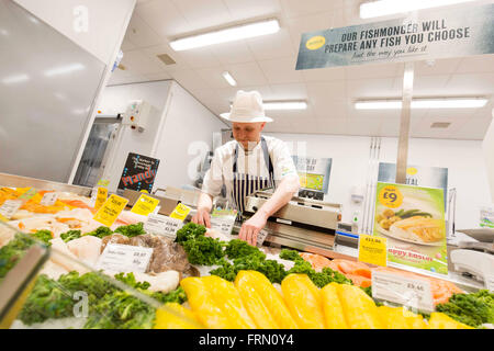 A fishmonger at a Morrisons fresh look store - Stock Photo