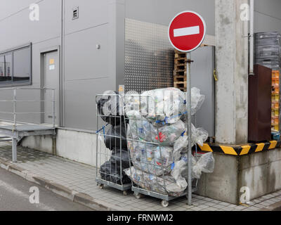 VILNIUS, LITHUANIA - MARCH 12, 2016: Plastic bags with the used bottles from under Coca Cola and other drinks are prepared for p Stock Photo
