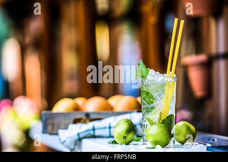 Mojito. Mojito cocktail. Cocktail glass on the bar counter outdoors. Alcoholic drink. - Stock Photo