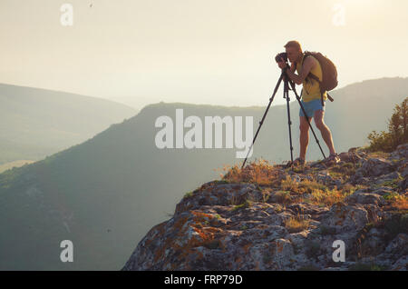 Photograph work in mountain. Job scene. - Stock Photo