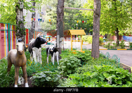 green yard and garden figurines in nursery school - Stock Photo