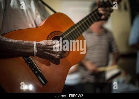 Hand of a Cuban Guitarist Strumming a Hand-Made Guitar in Santa Clara, Villa Clara, Cuba. Close-up. - Stock Photo