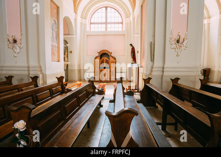 Minsk, Belarus - May 20, 2015: Empty benches in Cathedral of Saint Virgin Mary in Minsk, Belarus. - Stock Photo