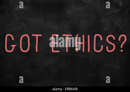 Code of ethics concept written on blackboard - Stock Photo