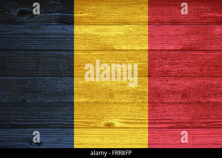 Chad Flag painted on old wood plank background - Stock Photo