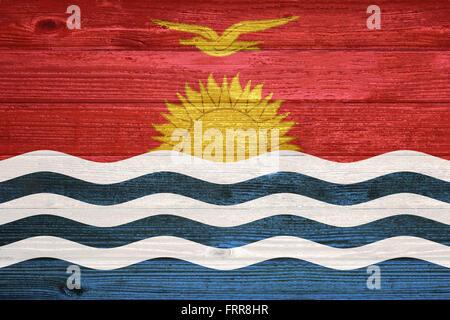 Kiribati Flag painted on old wood plank background - Stock Photo