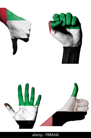 hands with multiple gestures (open palm, closed fist, thumbs up and down) with United Arab Emirates flag painted - Stock Photo