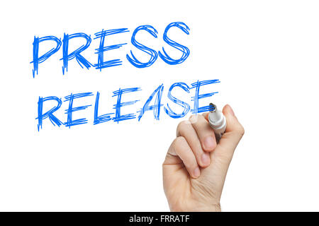 Hand writing press release on a white board - news concept - Stock Photo