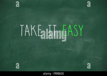 Take it easy handwritten on school blackboard - Stock Photo