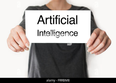 Artificial intelligence. Female in black shirt showing or holding a card - Stock Photo