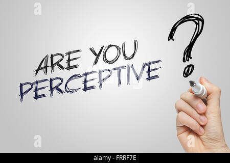 Hand writing perception on grey background - Stock Photo
