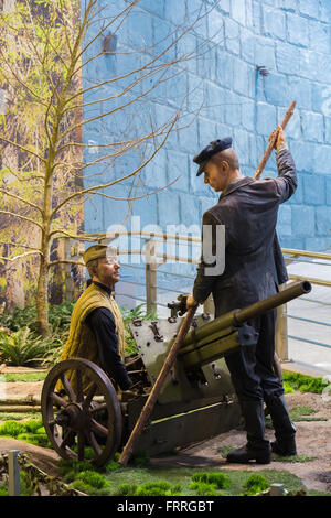 Minsk, Belarus - December 20, 2015: Soviet Belarusian partisans with cannon In The Belarusian Museum Of The Great - Stock Photo