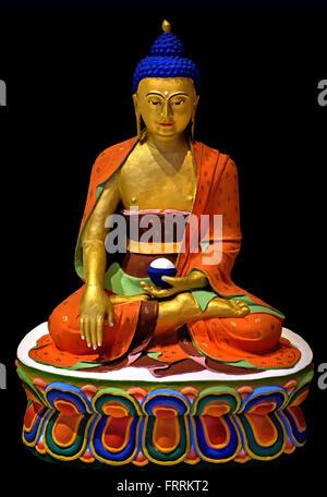 Buddha Shakyamuni usually the main picture on a Bhutanese altar   Thimphu Bhutan clay paint gold and copper ( Bhutan, - Stock Photo