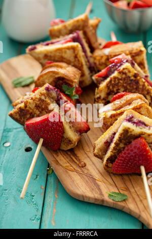 French toast pieces on a skewer with strawberry - Stock Photo