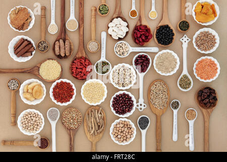 Large superfood sampler for good health in spoons and bowl forming an abstract background. High in antioxidants - Stock Photo