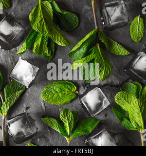 Fresh mint with ice cube on the stone table square - Stock Photo