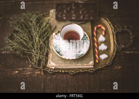 Tea set with  blurred herb and chocolate on the wooden table horizontal - Stock Photo