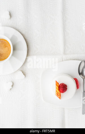 White cake with raspberry and coffee vertical - Stock Photo
